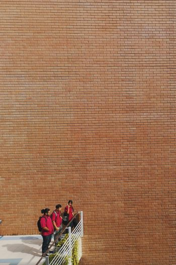High angle view of people on wall