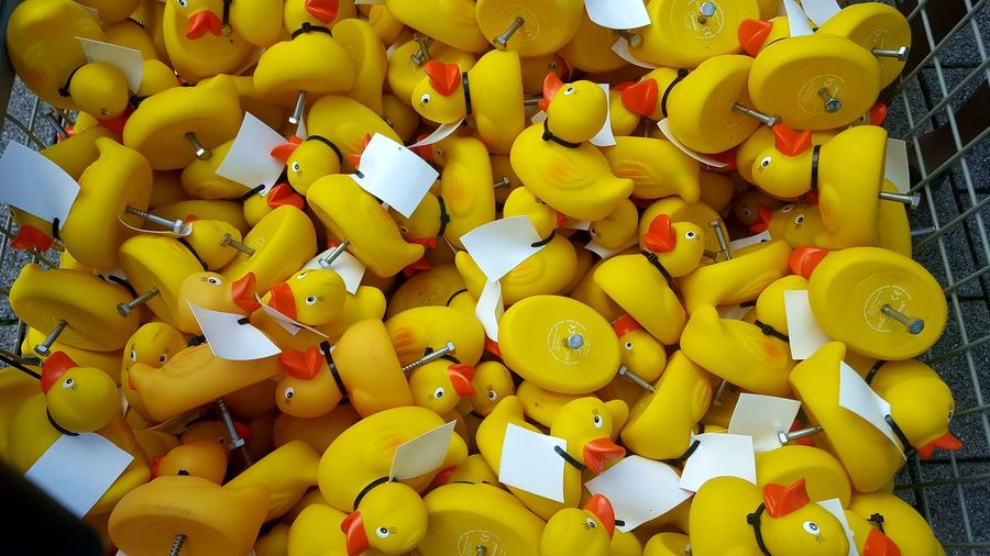 High angle view of yellow toys for sale
