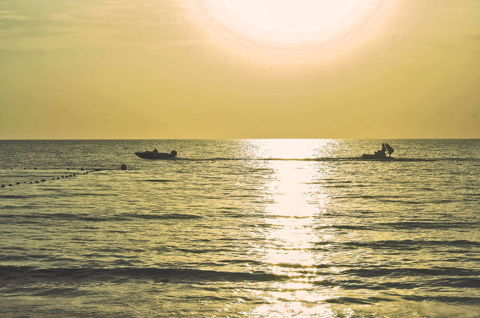 Beauty In Nature Day Horizon Over Water Nature Outdoors Play With Water Real People Reflection Scenics Sea Silhouette Sky Sun Sunlight Sunset Tranquil Scene Tranquility Water