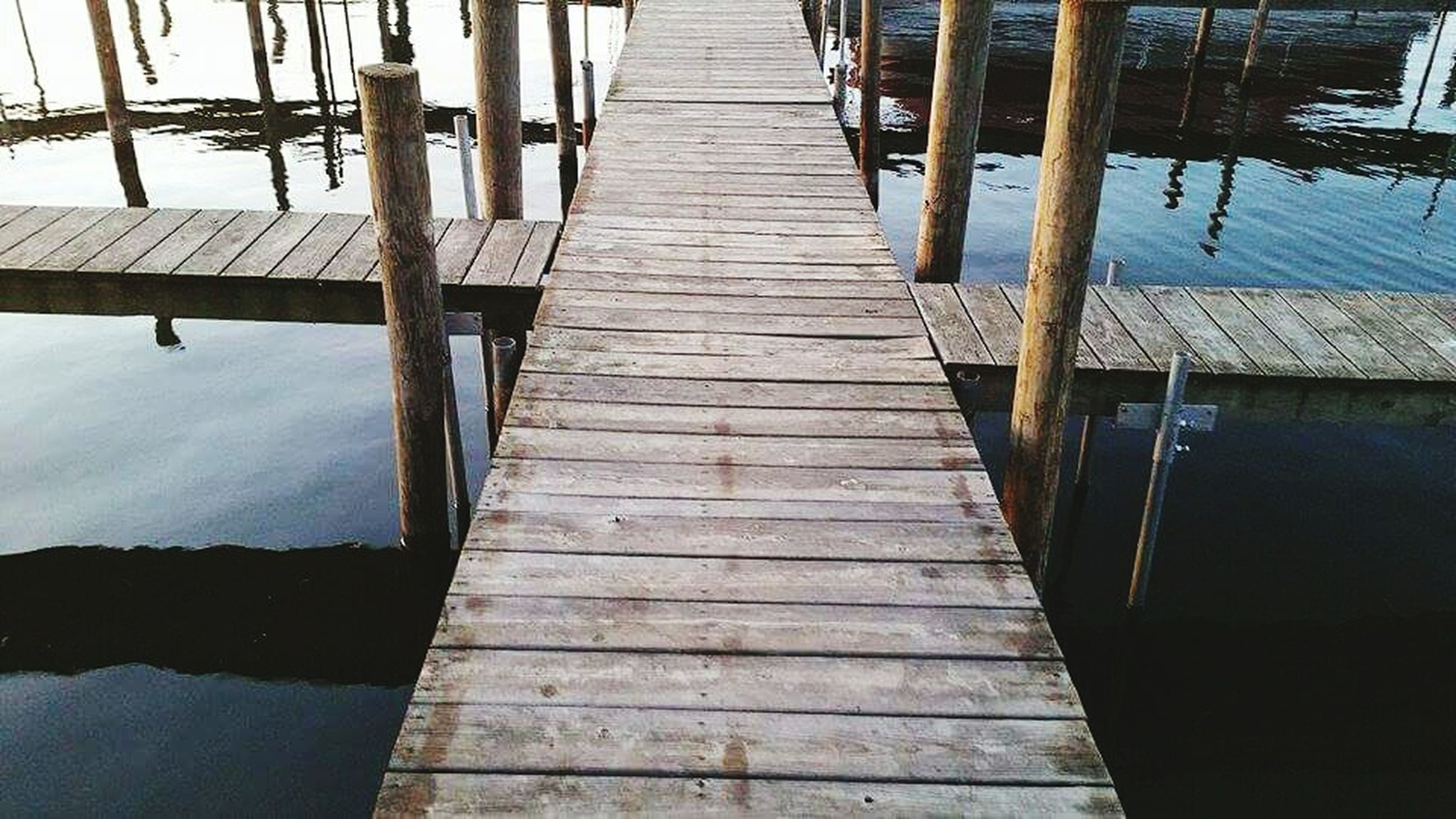 water, railing, pier, built structure, the way forward, wood - material, architecture, diminishing perspective, wood, footbridge, boardwalk, day, river, reflection, jetty, no people, sea, connection, lake, outdoors
