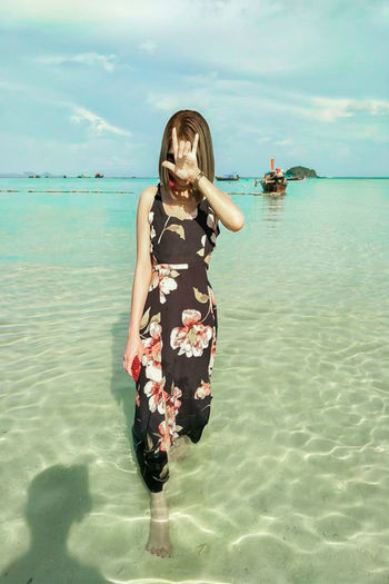 On the Sea Adult Beach Beauty In Nature Day Hairstyle Horizon Over Water Land Leisure Activity Lifestyles Nature One Person Outdoors Real People Sea Sky Standing Three Quarter Length Water Women Young Adult Young Women