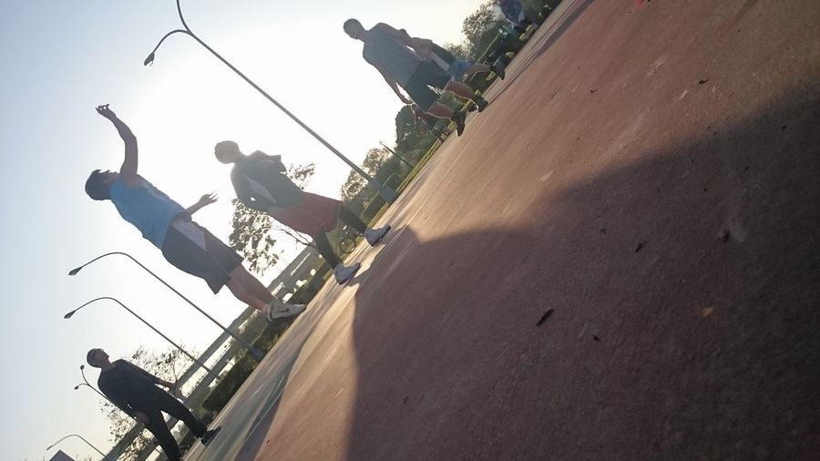 Basketball Day Full Length Group Of People High Angle View Leisure Activity Lifestyles Light And Shadow Men Mode Of Transportation Motion Nature Outdoors People Real People Ride Riding Shadow Sky Sport Sunlight Transportation
