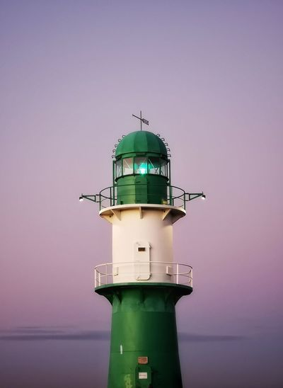 Low angle view of lighthouse at beach against sky