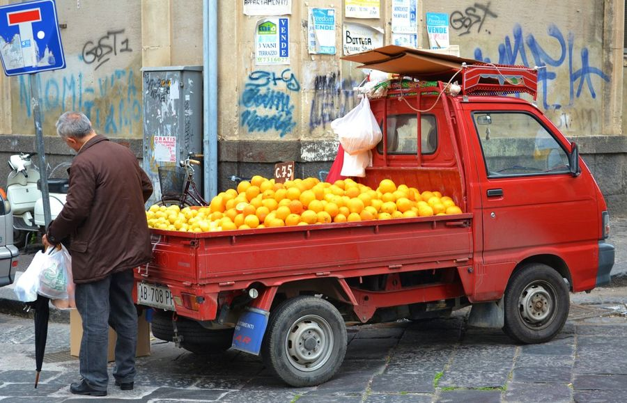 Man buying oranges in Catania Italy from a small red truck Basket Catania Choice City Feel The Journey Food For Sale Italy Lifestyles Oranges Retail  Roadsidephotography Selection Small Business Adapted To The City #urbanana: The Urban Playground