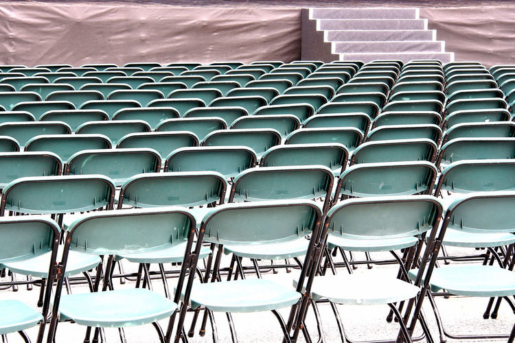 High angle view of empty chairs arranged outdoors