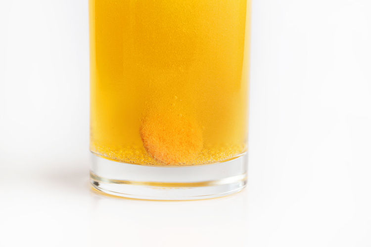 Effervescent vitamin C tablet bubbles in glass of water Yellow Studio Shot White Background Indoors  Close-up Food And Drink No People Still Life Glass - Material Freshness Glass Drink Cut Out Drinking Glass Food Orange Color Household Equipment Single Object Transparent Soluble Bubbles Vitamin C Effervescent Tablet Healthy Lifestyle Healthy Eating Healthcare And Medicine Supplements