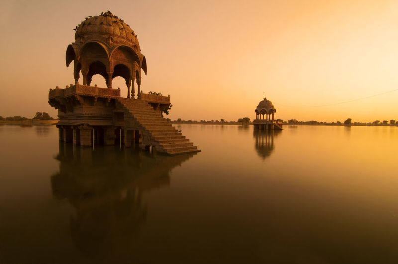 India Architecture Building Exterior Built Structure Clear Sky Gadi Sagar Lak Lake Nature No People Rajasthan Reflection Religion Sky Sunset The Past Tourism Travel Travel Destinations Water Waterfront