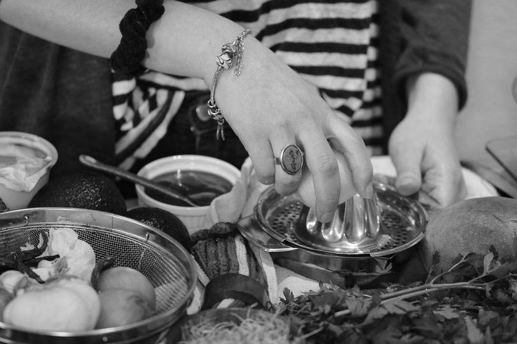 Midsection of people preparing food
