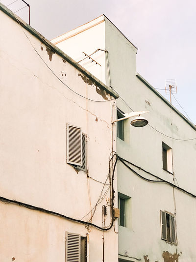 Façade Lines And Angles Architectural Detail Architectural Feature Architecture Architecturelovers Building Exterior Built Structure Cable City Day Electricity  Lines, Shapes And Curves Low Angle View No People Outdoors Pastel Pastel Colors Sky Streetlight Technology Window Windows