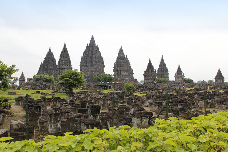 Prambanan Temple with the ruins, Yogyakarta, Indonesia ASIA Hinduism History Through The Lens  INDONESIA Java Ruins Yogyakarta Ancient Civilization Architecture Bas Relief Building Built Structure Carving Hindu Temple History Nature Old Outdoors Place Of Worship Prambanan Religion Sky The Past Travel Wall - Building Feature