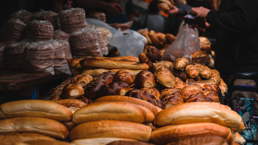 Close-up of baked pastry items for sale at market stall