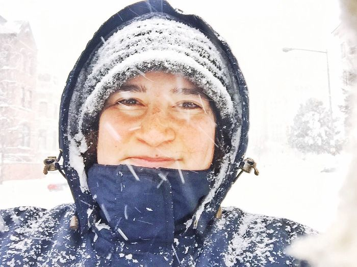 Portrait of woman standing on street during winter