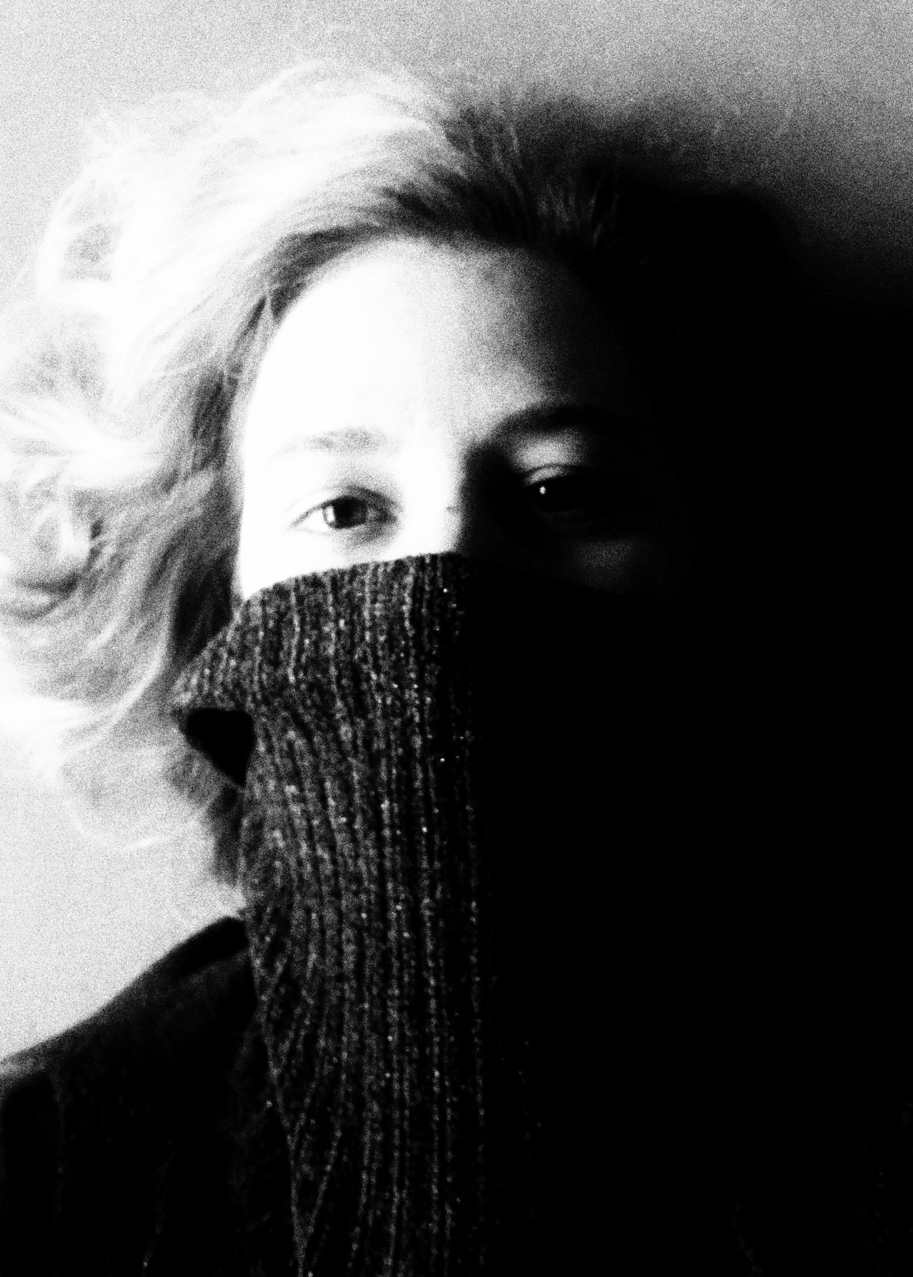 portrait, one person, looking at camera, headshot, young adult, body part, lifestyles, real people, front view, close-up, human body part, human face, young women, leisure activity, obscured face, covering, indoors, women, human eye, beautiful woman, teenager, warm clothing, scarf