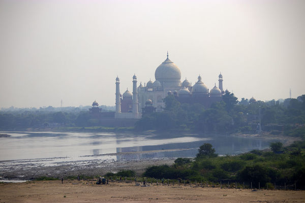 Taj Mahal from across city India Taj Mahal Agra Architecture Built Structure Dome Place Of Worship Religion Sky Tourism Travel Travel Destinations Water