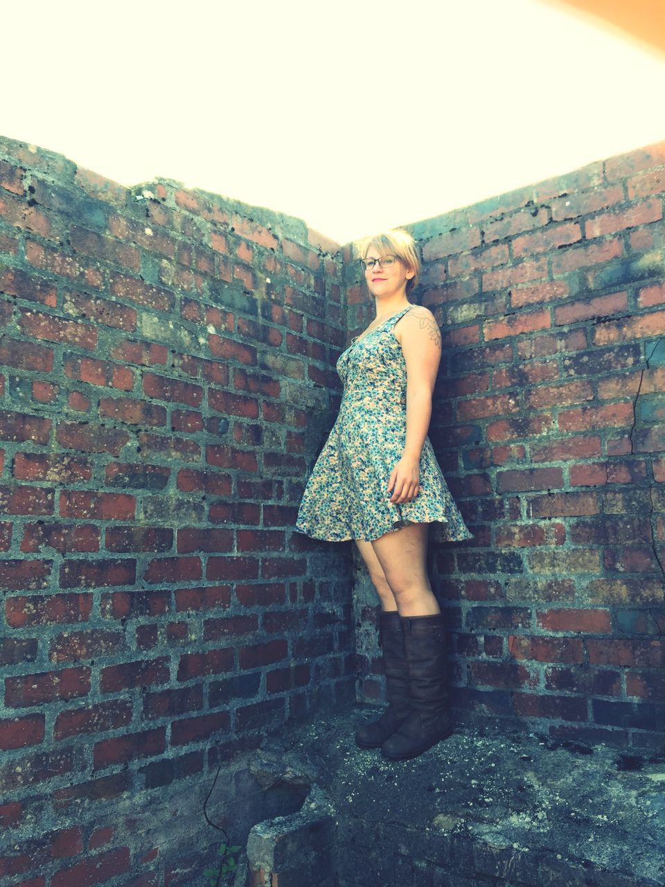 brick wall, standing, young adult, one person, young women, real people, looking at camera, leisure activity, outdoors, portrait, beautiful woman, full length, lifestyles, day, architecture, people
