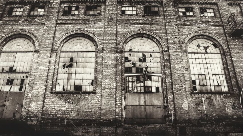 nr.67Architecture Arch Day Built Structure Building Exterior Window No People Outdoors Street Architecture Streetphotography City Blackandwhite City Life Bw_collection Shadow Cityscapes TheWeekOnEyeEM City Street Close-up Shades Of Grey City View  Urbex Urbanphotography Old Ruin
