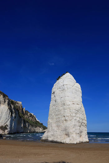 Pizzomunno, rock on the beach, Vieste, Gargano, Puglia, Italy Beauty In Nature Day Geology Italy Landscape Nature No People Outdoors Pizzomummo Puglia Rock Rock - Object Scenics Sea Sky Vieste Vieste Puglia Water