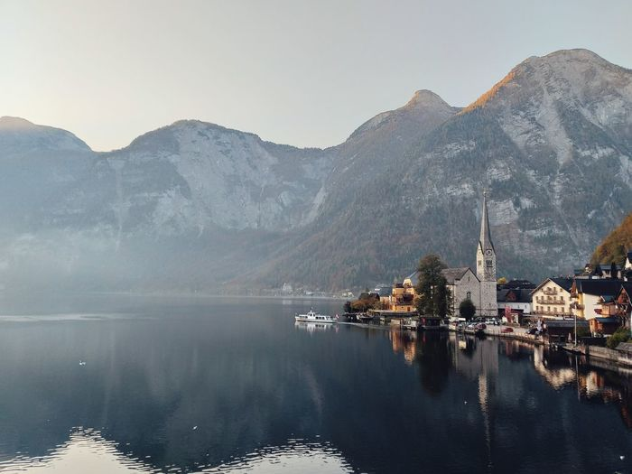 Travel Lake View Beauty In Nature Autumn Freshness Austria Hallstatt Wallpaper Environment Naturelovers Wonderful Place Wonderful View Houses Nature Environmental Conservation Beautiful Nature Nature Photography Traveling Water Mountain Tree Lake Reflection Sky Landscape Architecture Foggy Fog Rocky Mountains Village