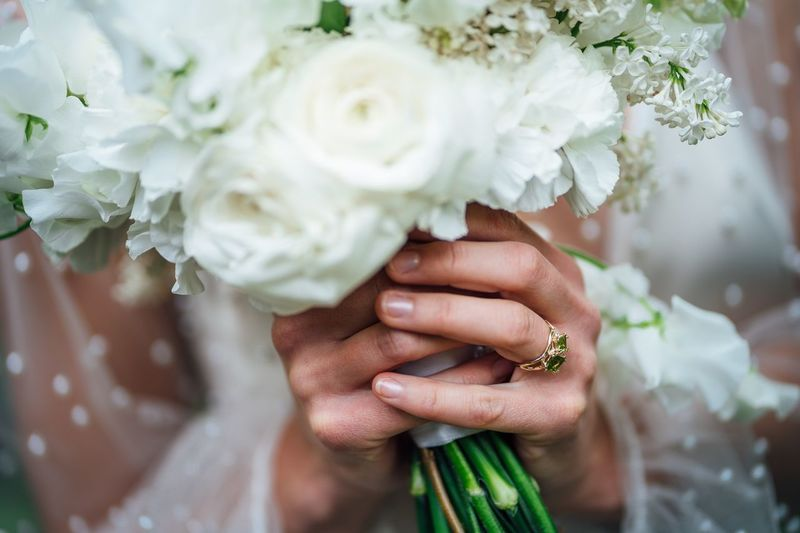 Wedding bouquet with emerald ring Wedding Ring Roses White Roses White Rose Wedding Bouquet Emerald Flower Flowering Plant Human Hand Plant Wedding Hand Human Body Part Bouquet Bride Flower Arrangement Women Adult Newlywed Ring Celebration
