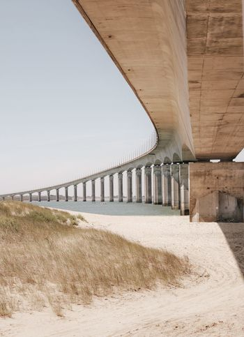 Bridge - Man Made Structure Architectural Column Clear Sky Sand Beach Business Finance And Industry Architecture Built Structure Sky