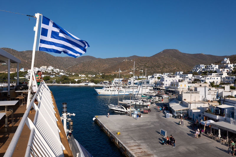 Amorgos Ferry Amorgos Architecture Bay Blue Boat Building Exterior Built Structure City Clear Sky Day Flag Greece Greece Flag Harbor High Angle View Katapola Mode Of Transportation Mountain Nature Nautical Vessel No People Outdoors Patriotism Sky Transportation Water