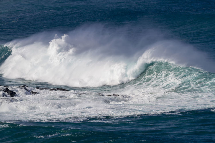 Big Ocean wave crashing on the rocks, Waimea Bay Oahu Hawaii BIG Giant Oahu Hawaii Wind Spray Beach Beauty In Nature Blue Day Huge Motion Nature No People North Shore Ocean Waves Outdoors Power In Nature Rocks Scenics Sea Surf Photography Waimea Bay Water Waterfront Wave Waves