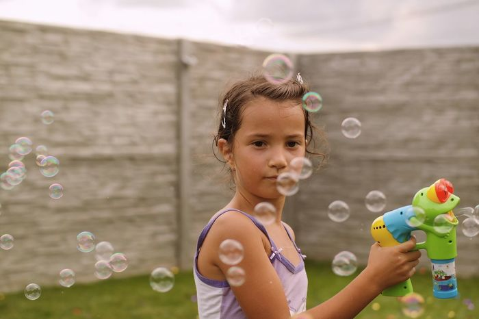 Dreamy bubbles... Bubble Bubble Wand Childhood Soap Sud Blowing Leisure Activity Real People Elementary Age Focus On Foreground Casual Clothing Girls Fragility Fun Lifestyles Mid-air Enjoyment Holding Playing Details Of My Life Made In Romania VSCO My Favorite Photo Summer Playtime Live For The Story Place Of Heart Sommergefühle Mix Yourself A Good Time The Week On EyeEm The Portraitist - 2018 EyeEm Awards