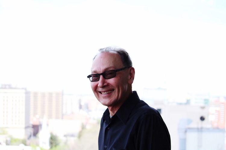 Close-up portrait of smiling senior man wearing eyeglasses