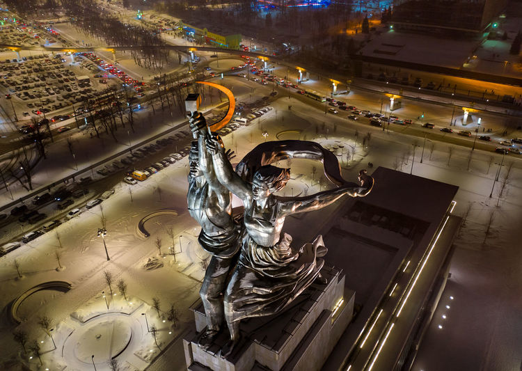 High angle view of statue in city at night