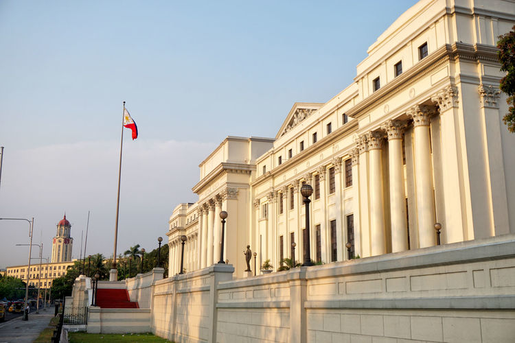 Landmarks in Manila Manila City Hall Manila, Philippines National Museum Manila Architecture Building Building Exterior Built Structure City Clear Sky Day Flag History Low Angle View Outdoors Travel Destinations