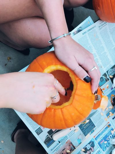 Human Hand Real People Hand Human Body Part Holding People Body Part Women High Angle View Lifestyles Two People Finger Day Adult Orange Color Human Finger Close-up Leisure Activity Paper Halloween Halloween_Collection Halloween EyeEm Carving Tradition Fall