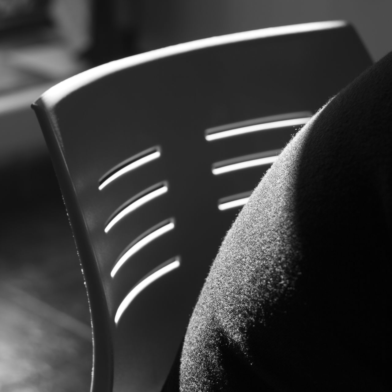 HIGH ANGLE VIEW OF PERSON IN CHAIR