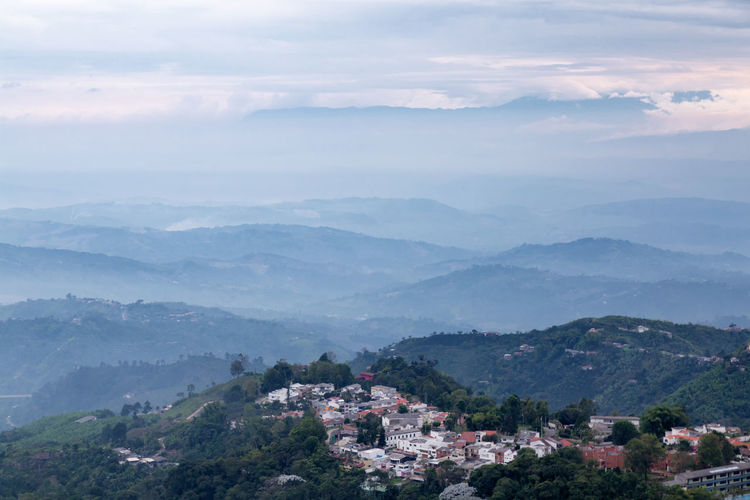Late afternoon view of the area outside of Manizales, Colombia. Andes Architecture City Cityscape Coffee Colombia Downtown Latin Manizales Nevado South Tourist View America Andean Caldas Coffee Triangle Colombian  Destination Landscape Mountain Mountain Range Outdoors Volcano Zone