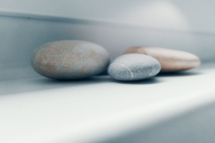 Pebbles Window Sill Close-up Indoors  Still Life No People Selective Focus Table Simplicity Studio Shot Solid Rock White Color Stone - Object Shape Group Of Objects Pebble