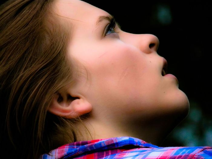 Close-Up Of Thoughtful Beautiful Young Woman Looking Up