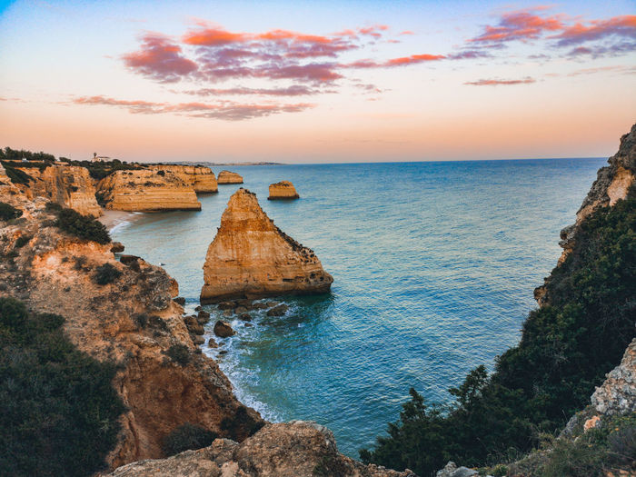 Praia da marinha Seascape Sea And Sky Huaweiphotography Praia Da Marinha Nature Photography Mar Huaweip20pro Rock Formation Water Sea Sunset Beach Blue Sand Rock - Object Sunlight Sky Horizon Over Water Low Tide Seascape Rocky Coastline Coastline Tide Wave Shore Ocean Coast Coastal Feature Calm Surf Stay Out
