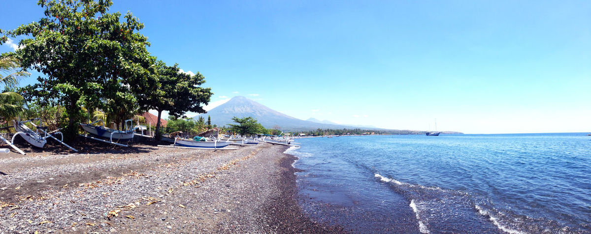 Bali Holiday INDONESIA Mount Agung Panorama Travel Traveling Vacations Wanderlust Amed Amed Beach , Bali Beach Beauty In Nature Blue Clear Sky Day Explore Nature No People Outdoors Road Scenics Sea Sky Sunlight The Way Forward Tranquil Scene Tranquility Transportation Travel Destinations Tree Water