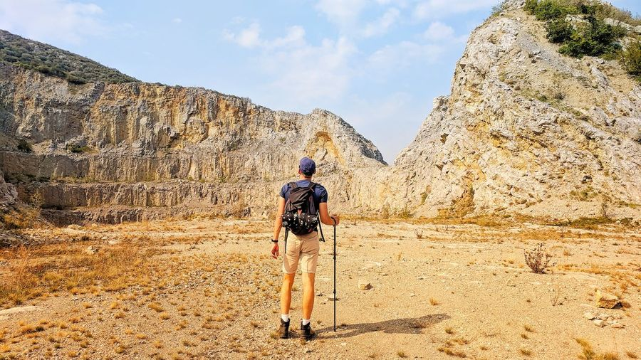 Hiker in desert Serbia From Behind Full Length Desert Men Photography Themes Sand Adventure Standing Sand Dune Photographing Arid Climate Hiker Backpack Hiking Trail Hiking Pole Mountain Climbing Geology Mountain Peak Explorer Rock Formation Rocky Mountains Arid Landscape