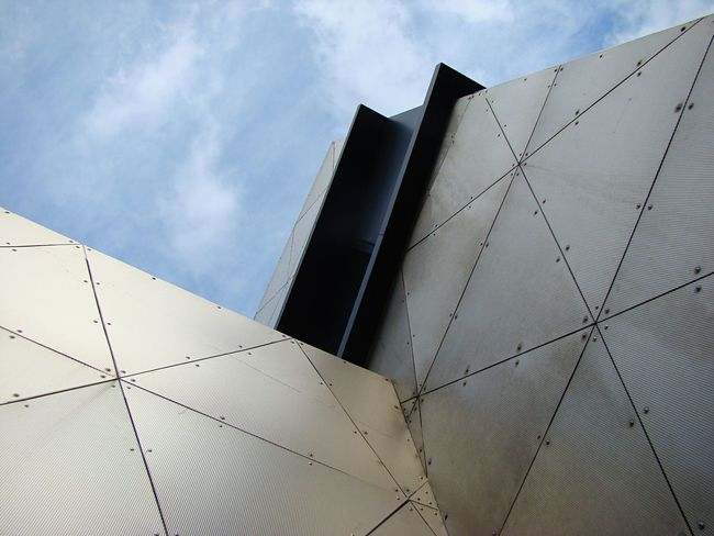 Built Structure Geometric Shape Repetition Architecture Architectural Feature No People Design Low Angle View Creative Façade Exterior Building Exterior Modern Patterns & Textures Angels Angular Contemporary Lines Plains Metal Metallic Holes Screen