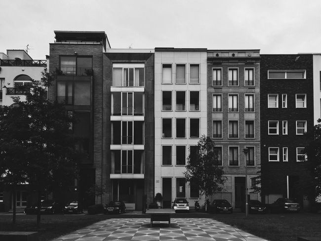 Modern city living. Architecture Berlin Berlin Mitte Berlin Photography Berliner Ansichten Black Blackandwhite Building Exterior Built Structure City Day Modern Architecture No People Outdoors Sky Streetphotography Tabletennis Tree White Window