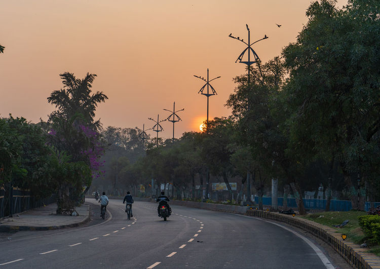 """"""" Life which follows the nature """" SonyA7III Sonyalpha Streetphotography Street India Streetphoto_color Landscape_Collection Man Sunrise Sunrise_sunsets_aroundworld Sunrise_Collection Road Fitness Morning Morning Sky EyeEm Best Shots King - Royal Person City Tree Full Length Sky Street Scene Riding Cycling Vehicle Bicycle Lane Racing Bicycle Bicycle Motor Scooter Motorcycle"""