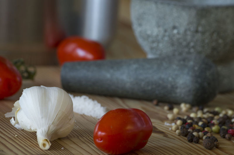 Close-Up Of Ingredients With Mortar And Pestle On Table