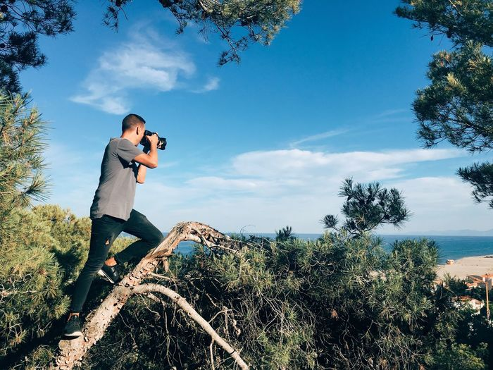 Photographer of nature Man Young Man Horizontal Nature Adventure Photographer Photography Photo Nature Day Photographing Casual Clothing Sunlight Photography Themes Outdoors Activity Technology