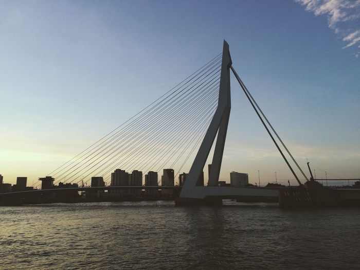Low Angle View Of Erasmus Bridge Over Meuse River Against Sky