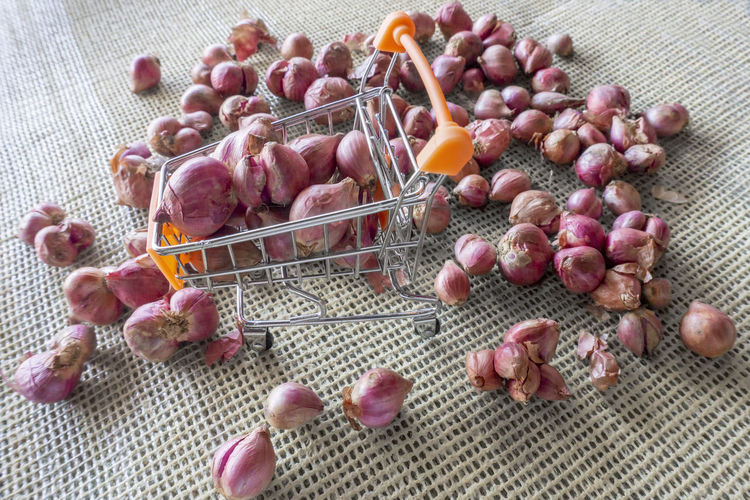 Red onion for sale Abundance Choice Close-up Day Food Food And Drink Freshness Fruit Healthy Eating High Angle View Indoors  Large Group Of Objects Meat Multi Colored No People Onion Pink Color Raw Food Red Onion Still Life Variation Wellbeing