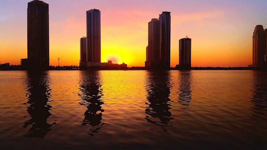 First Eyeem Photo Waterfront Beach Urban Skyline Modern City Life Built Structure Water Sky Tower Tall - High Sand Outdoors Architecture Vacations Sea Skyscraper Shore Coastline Building Exterior City