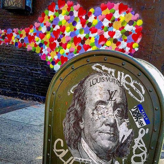 @deerazo w/ @hektad._official mural in the background. Photo by @epok_artography Streetart NYC Newyork Manhattan Eastvillage Nystreetart StreetArtNYC Louievuitton Deerazo Hektad Art Mural Wheatpaste Benfranklin Love Money Hearts Streetartphotography