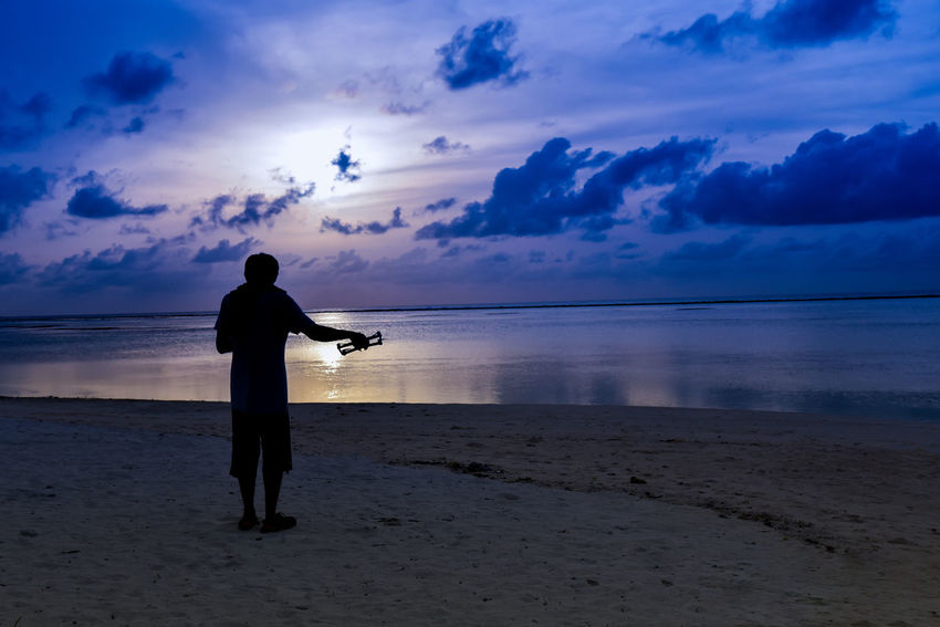 Drone  Freedom Maldives Silhouette Sky And Clouds Beach Beauty In Nature Control Drone Dronephotography Full Length Lifestyles Nature Ocen  Real People Sand Scenics Sea Silhouette Sky Sky And Sea Standing Sunset Tranquil Scene Tranquility Water