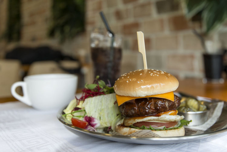 Close-up of burger with drink on table
