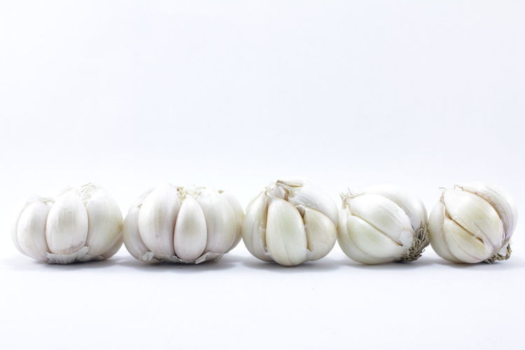 Garlic on a white background Garlic On A White Background Close-up Day Food Food And Drink Freshness Garlic Healthy Eating Indoors  No People Studio Shot White Background White Color